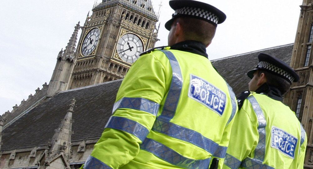 Police officers patrol past The Houses of Parliament in London.