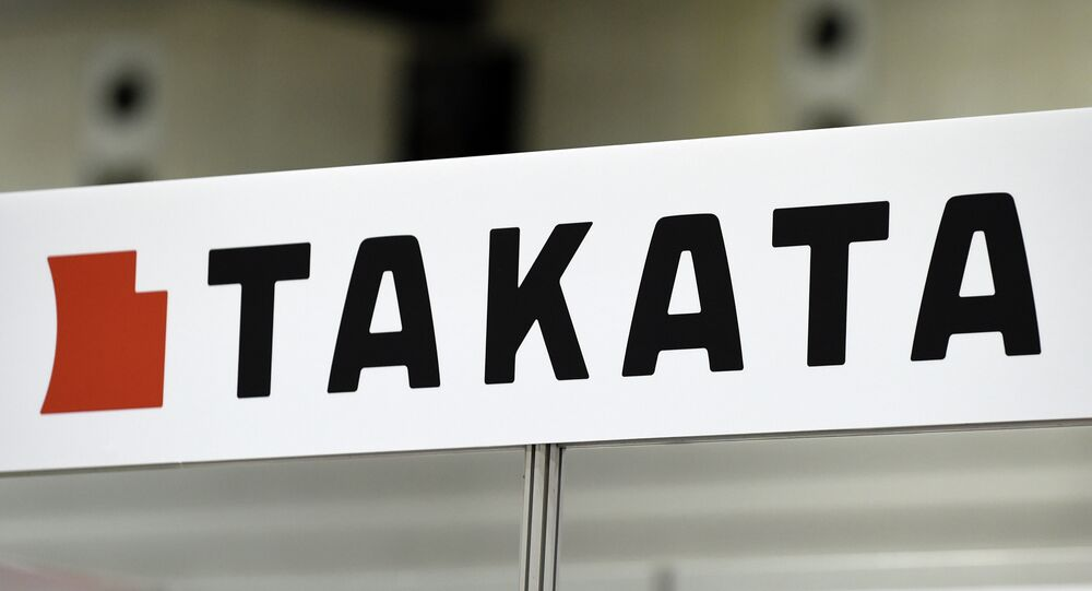 Japanese auto parts maker Takata's logo being displayed at an event in Yokohama, suburban Tokyo