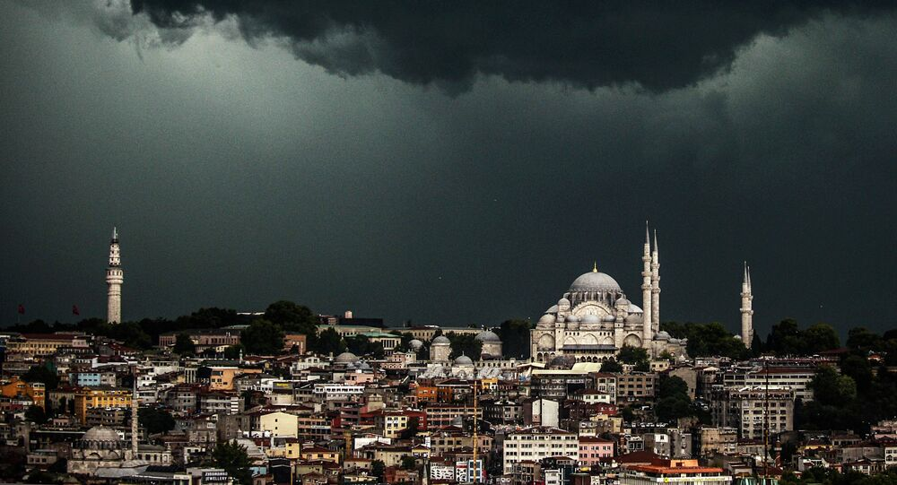 Clouds gather over the Suleymaniye Mosque (R) during a storm on August 7, 2014, in Istanbul