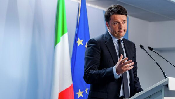 Italian Prime Minister Matteo Renzi speaks during a media conference after an emergency EU summit at the EU Council building in Brussels. - Sputnik International