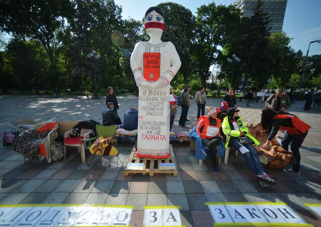 People protest against foreign currency loans in Kyiv