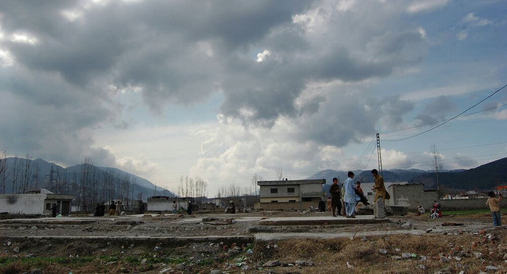 Pakistani children play at the demolished compound of Osama bin Laden in Abbottabad, Pakistan.