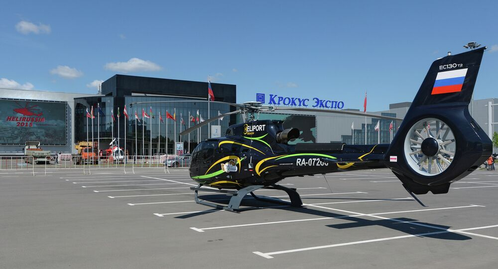 A Eurocopter EC-130T2 helicopter by Moscow's Crocus Expo exhibition hall before the HeliRussia 2015 expo.