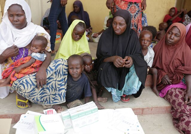 Women and children rescued by Nigerian soldiers from Boko Haram extremists at Sambisa Forest wait for treatment at a refugee camp in Yola, Nigeria.