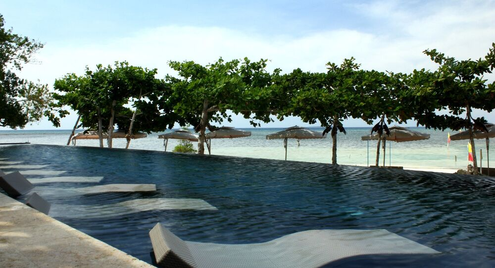 An infinity pool that extends the view to the beach in Baclayon, province of Bohol, Philippines.