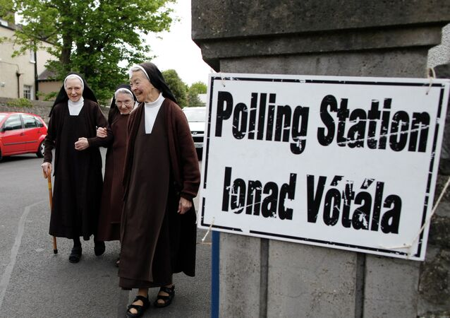 Carmelite sisters leave a polling station in Malahide, County Dublin, Ireland, Friday, May 22, 2015. Ireland began voting Friday in a referendum on gay marriage.