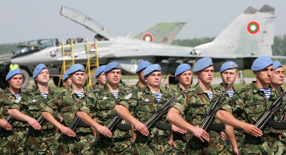 Bulgarian special forces soldiers parade walk in front of the Mig-29 jet fighter