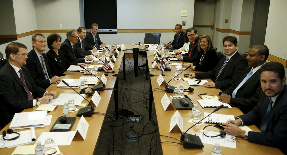 Assistant US Secretary of State for Western Hemisphere Affairs Roberta Jacobson (3rd L) and Josefina Vidal (4th R), director general of the US division of the Cuban foreign ministry, sit with their delegations at the fourth round of closed talks to re-establish diplomatic relations between the United States and Cuba at the State Department in Washington May 21, 2015