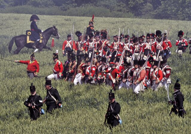 People in period uniforms fight during a re-enactment of the 1815 Battle of Waterloo between the French army led by Napoleon and the Allied armies led by the Duke of Wellington and Field-Marshal Blucher, on June 17, 2012, in Waterloo