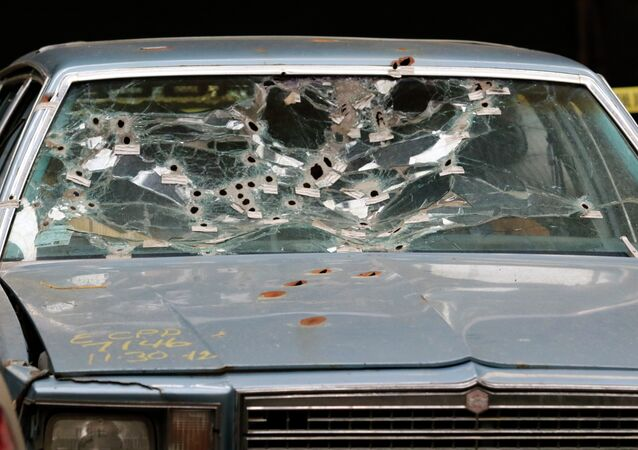 The car driven by Timothy Russell is shown Friday, April 10, 2015, in Cleveland. Cleveland police officer Michael Brelo, 31, was found not guilty of voluntary manslaughter in the November 2012 deaths of Russell, 43, and Malissa Williams, 30, after a high-speed chase.