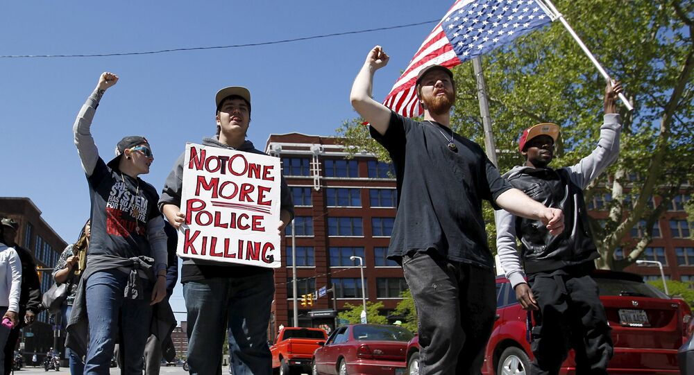 Protesters walk outside the Justice Center following the not guilty verdict for Cleveland police officer Michael Brelo on manslaughter charges in Cleveland, Ohio, May 23, 2015