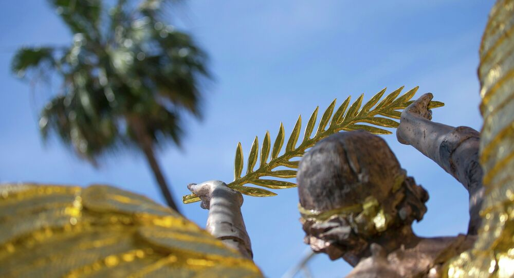 A Golden Angel statue, commemorating the 100th anniversary of the WW1, shows a Palme d'Or symbol outside the Carlton Hotel before the start of the 68th Cannes Film Festival in Cannes, Southern France, May 11, 2015