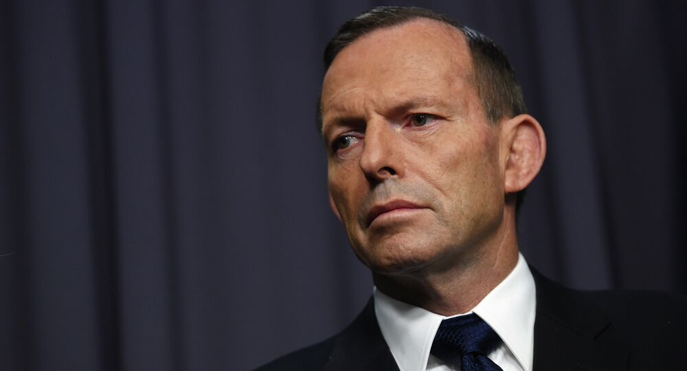 Abbott urges lifting of virus restrictions