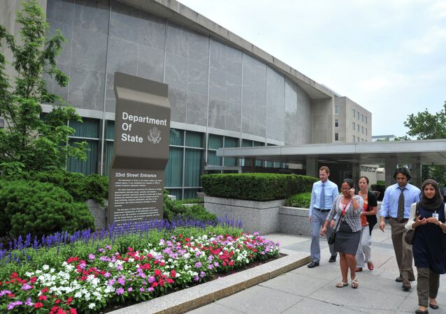 People walk past the US State Department building July 6, 2011 in Washington, DC