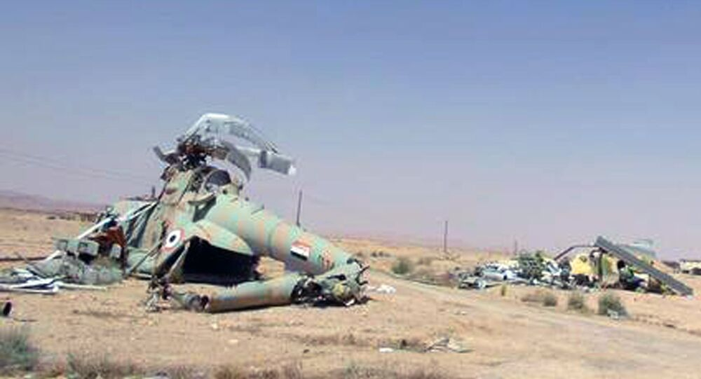 This picture released on Thursday, May 21, 2015 by the website of Islamic State militants, shows damaged Syrian military helicopters at Palmyra air base that was captured by the Islamic State militants after a battle with the Syrian government forces in Palmyra, Syria