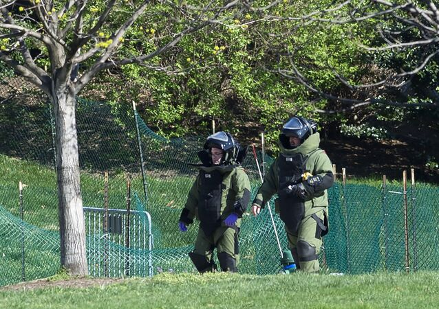 Members of the bomb squad responds to reports of a shooting at the US Capitol in Washington, DC, April 11, 2015