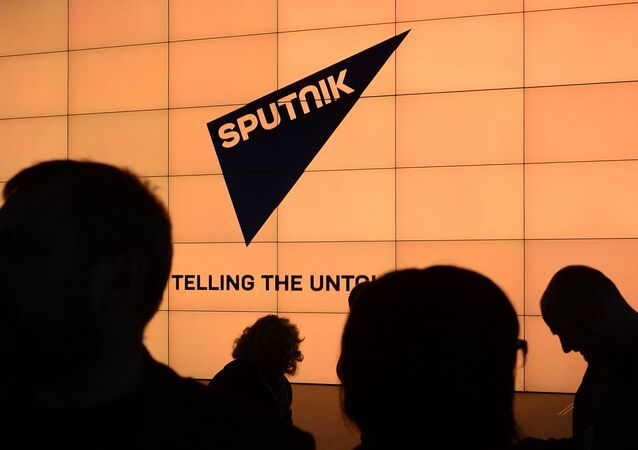 Logo of the international news brand, Sputnik.