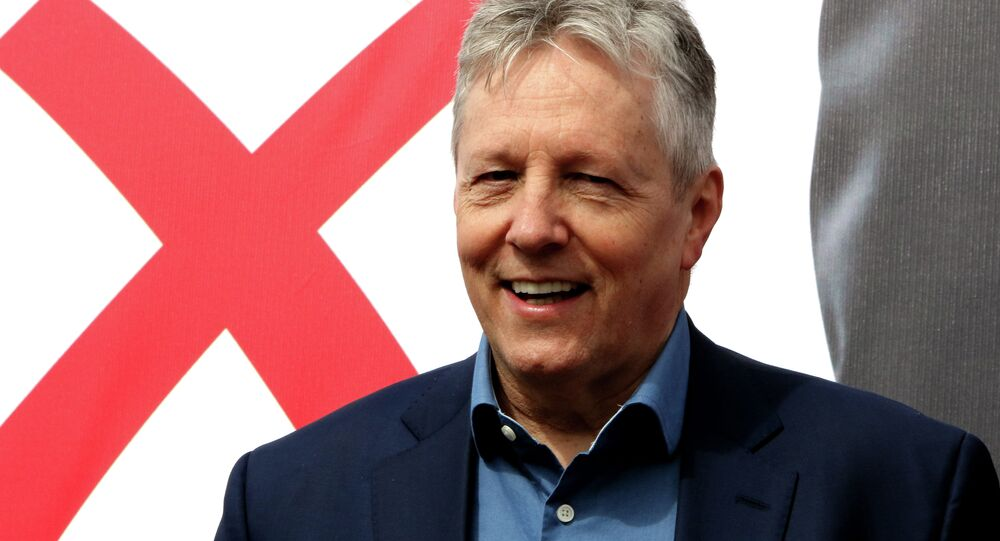 Peter Robinson, Northern Ireland First Minister and Leader of the Democratic Unionist Party (DUP) canvasses on the final day of campaiging on May 6, 2015 in Belfast