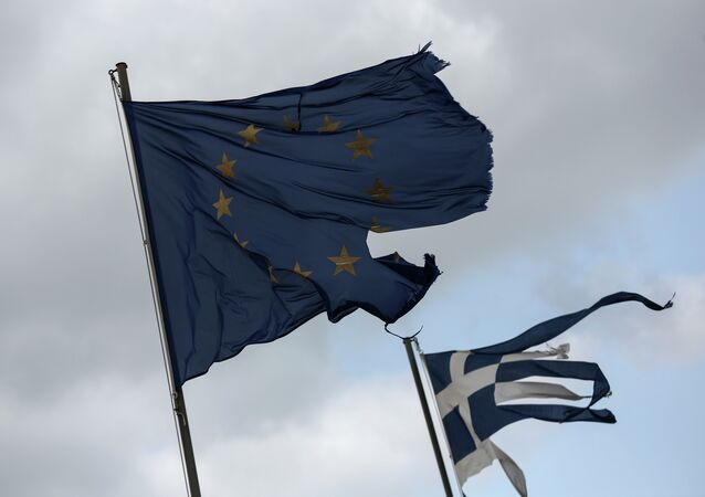 Ruined EU and Greek flags fly in tatters from a flag pole at a beach at Anavissos village, southwest of Athens, on Monday, March 16, 2015.