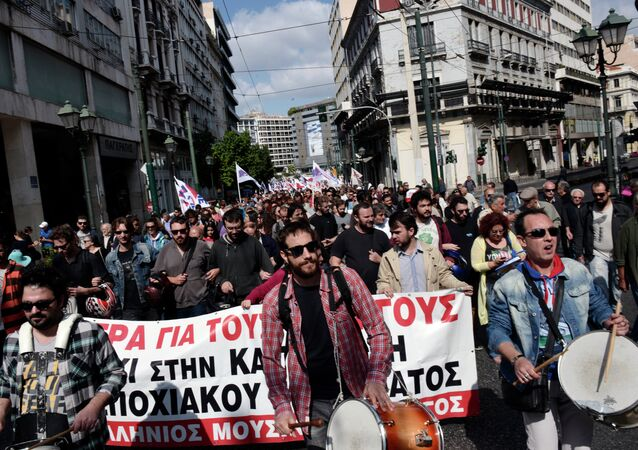 Communist affiliated protesters march in central Athens during a massive protest rally against unemployment and the austerity measures on October 4, 2014