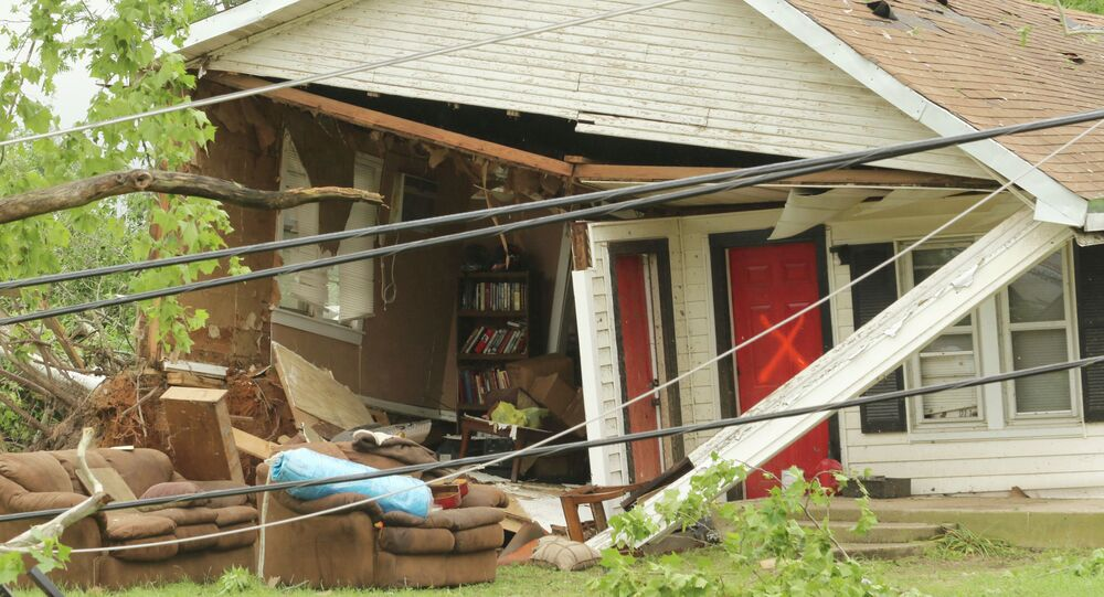 A home along E. Pennsylvania Street in Van, Texas, receive a X after it had been searched by emergency personnel, the home was damaged after severe weather moved through the area Monday, May 11, 2015
