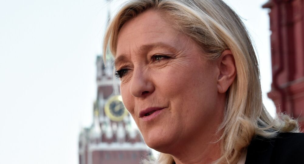 France's far-right Front National (FN) party president Marine Le Pen visits Moscow's Red Square before a meeting with Russia's State Duma speaker Sergei Naryshkin on May 26, 2015