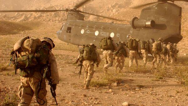 US troops board a helicopter in Afghanistan - Sputnik International