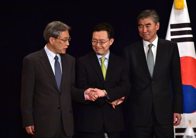 (L to R) Junichi Ihara, director-general of the Japanese Foreign Ministry's Asian and Oceanian Affairs Bureau, Hwang Joon-Kook, South Korean special representative for Korean Peninsula peace and security affairs, and Sung Kim, US special representative for North Korea policy before their meeting at a hotel in Seoul
