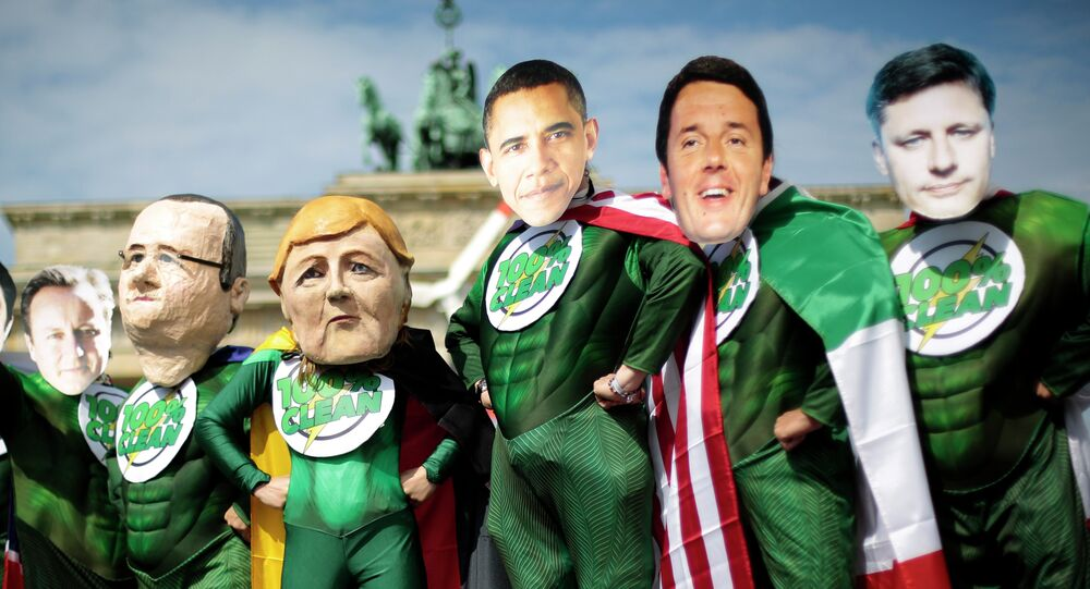 Activists in costumes and with masks of the G7 leaders