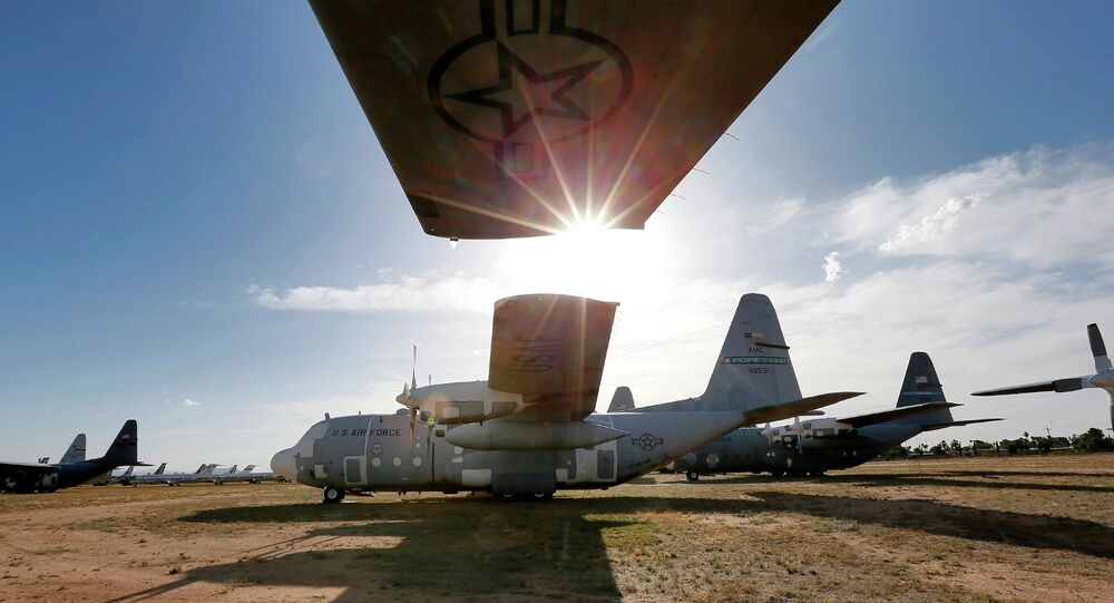Numerous C-130 cargo planes are lined up in a field at the 309th Aerospace Maintenance and Regeneration Group boneyard at Davis-Monthan Air Force Base in Tucson, Ariz