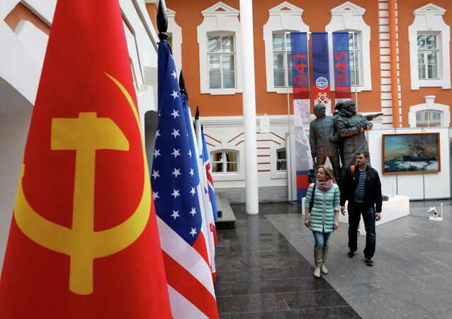 Visitors view exhibits at the opening of the exhibition Daily Challenges of Arctic Convoys, dedicated to the 70th anniversary of victory in the Great Patriotic War.