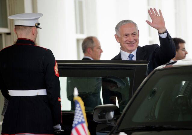 Israeli Prime Minister Benjamin Netanyahu waves as he exist the West Wing of the White House
