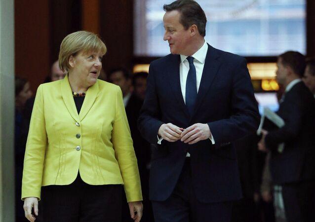 German Chancellor Angela Merkel, left walks with British Prime Minister David Cameron.