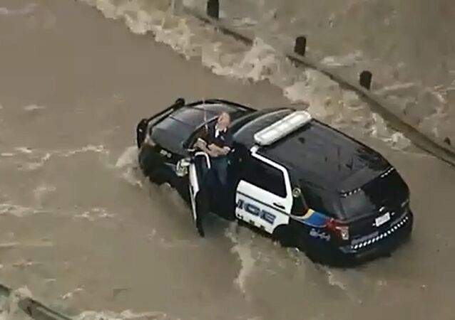 Police Officer Rescued from Texas Floods
