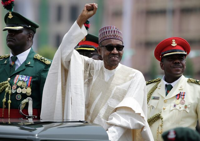 New Nigerian President, Muhammadu Buhari, salutes his supporters during his Inauguration in Abuja, Nigeria, Friday, May 29, 2015