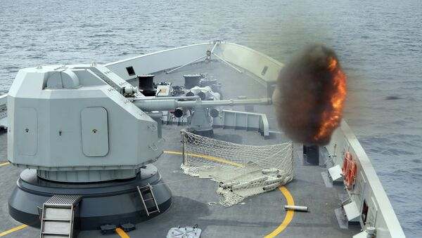 Anti-surface gunnery is fired from China's Navy missile frigate Yulin during the Exercise Maritime Cooperation 2015 by Singapore and Chinese navies in the South China Sea, May 24, 2015 - Sputnik International