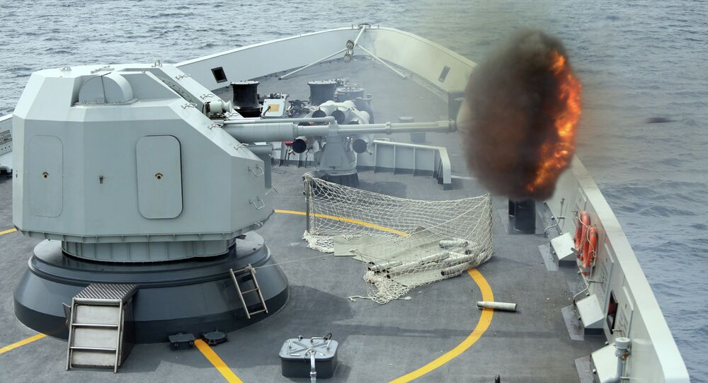 Anti-surface gunnery is fired from China's Navy missile frigate Yulin during the Exercise Maritime Cooperation 2015 by Singapore and Chinese navies in the South China Sea, May 24, 2015