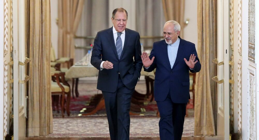 Iranian Foreign Minister Mohammad Javad Zarif, right, and his Russian counterpart Sergey Lavrov arrive to their joint press conference in Tehran, Iran