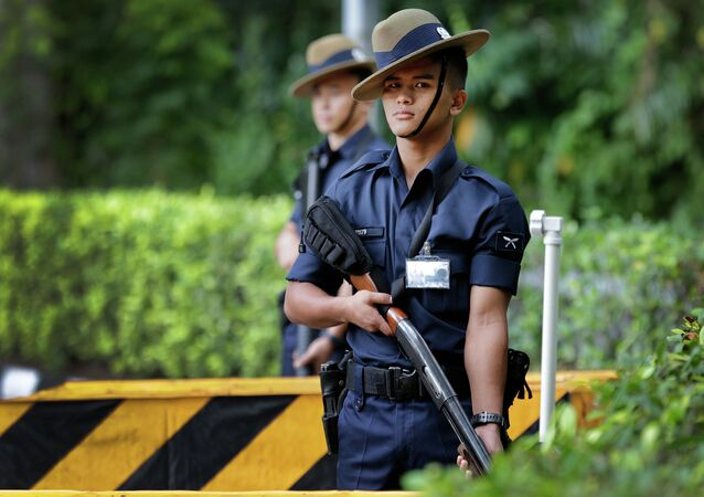 Singapore Gurkha policemen guard the grounds surrounding the venue of the 14th International Institute for Strategic Studies Shangri-la Dialogue, or IISS, Asia Security Summit, Sunday, May 31, 2015, in Singapore