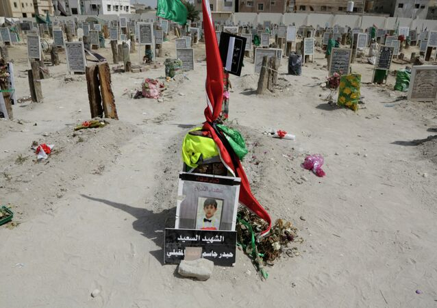 A sign on a child's grave reads: The happy martyr Haidar Jassam al-Maqaili, in memory of one of 21 victims of a May 22 mosque suicide bombing claimed by the Islamic State group in Qudeeh, Saudi Arabia, is seen on Saturday, May 30, 2015