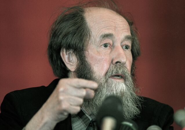 Writer Alexander Solzhenitsyn answering correspondents' questions at a news conference in Vladivostok.