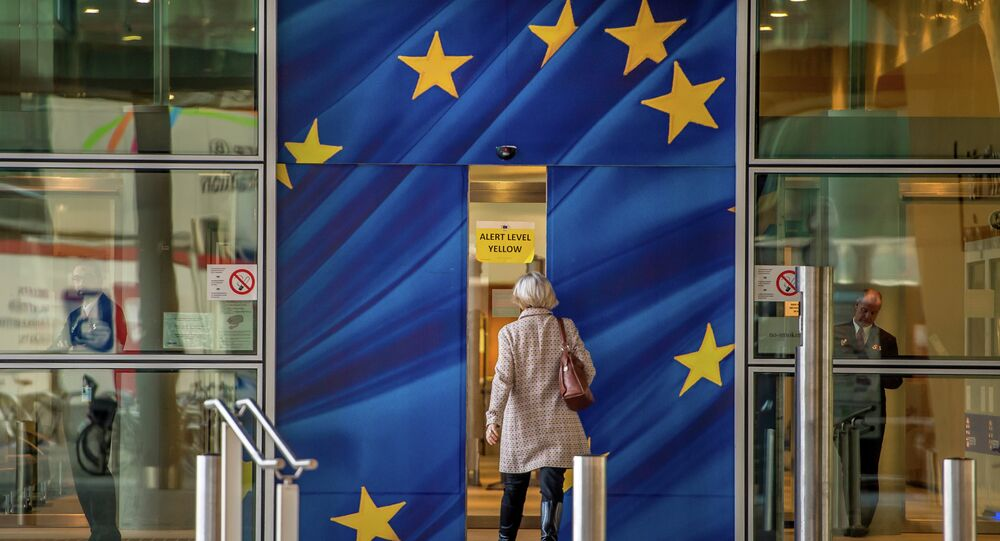 An image taken on April 24, 2015 shows a woman walking into the European Commission building in Brussels