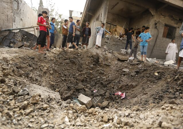 People gather at a site hit by a Saudi-led air strike in Yemen's capital Sanaa May 27, 2015