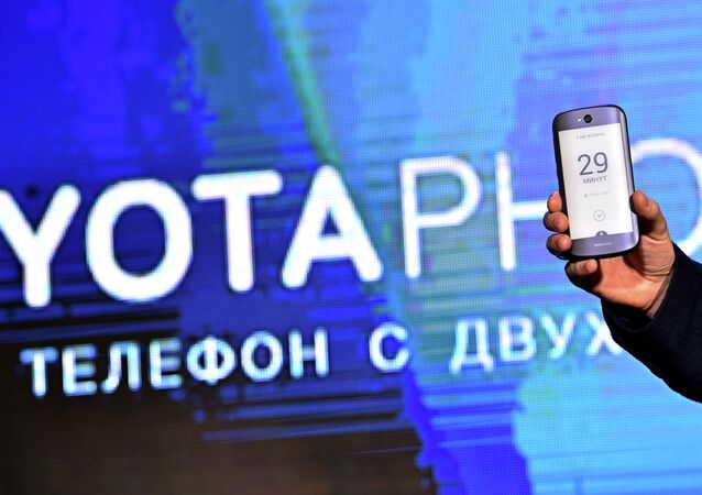 Head of Yota Devices Vladislav Martynov holds a Yotaphone with dual screen during its presentation in central Moscow on December 2, 2014