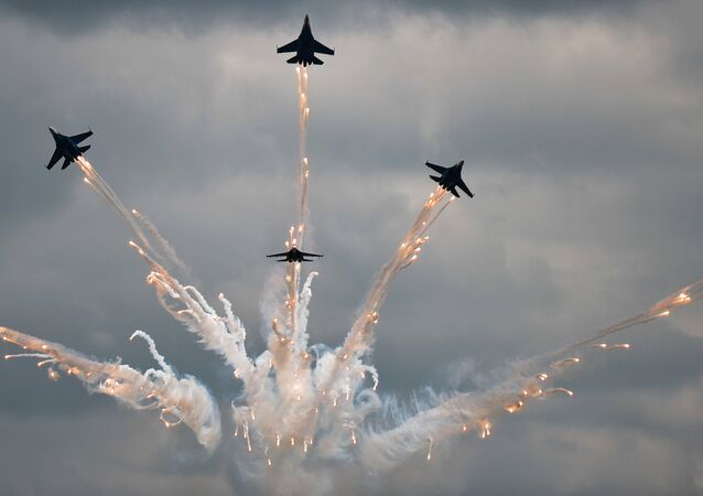 The Russkiye Vityazy (Russian Knights) aerobatic team performs in Sukhoi 27 jets at the Russian stage of the Aviadarts-2015 Flight Skills Competition in Voronezh