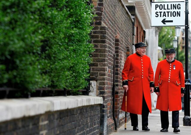 Chelsea Pensioners as they see the media after voting at a polling station in London.