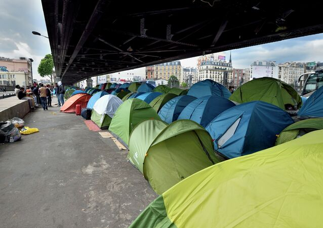 Hundreds of migrants, mostly from East Africa, live in this camp, some for a year, under the elevated railway near the Porte de la Chapelle in Paris on 26 May, 2015