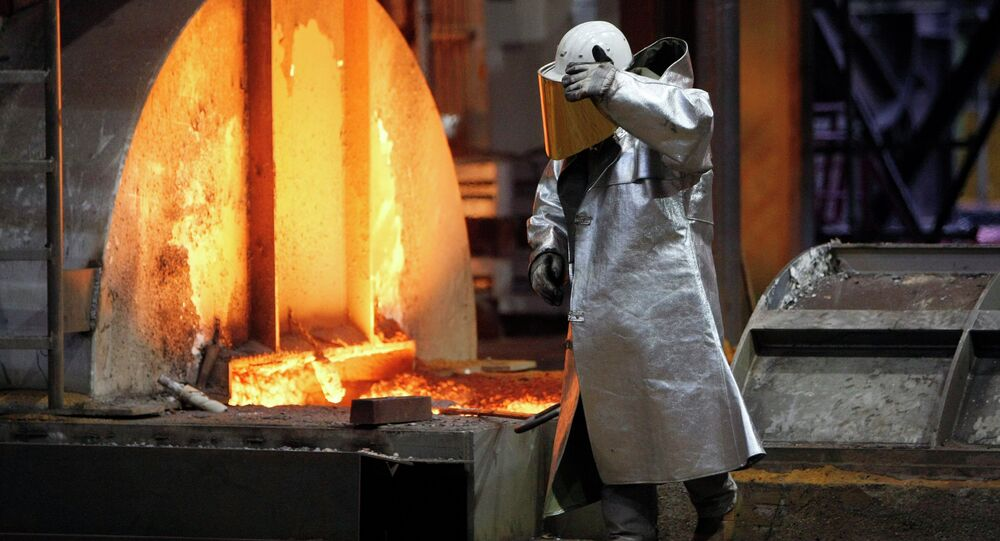 A worker walks in the new furnace at the ThyssenKrupp steel factory in Duisburg, Germany