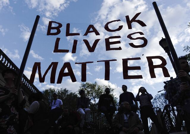 People take part in a rally on April 29, 2015 at Union Square in New York, held in solidarity with demonstrators in Baltimore, Maryland demanding justice for an African-American man who died of severe spinal injuries sustained in police custody
