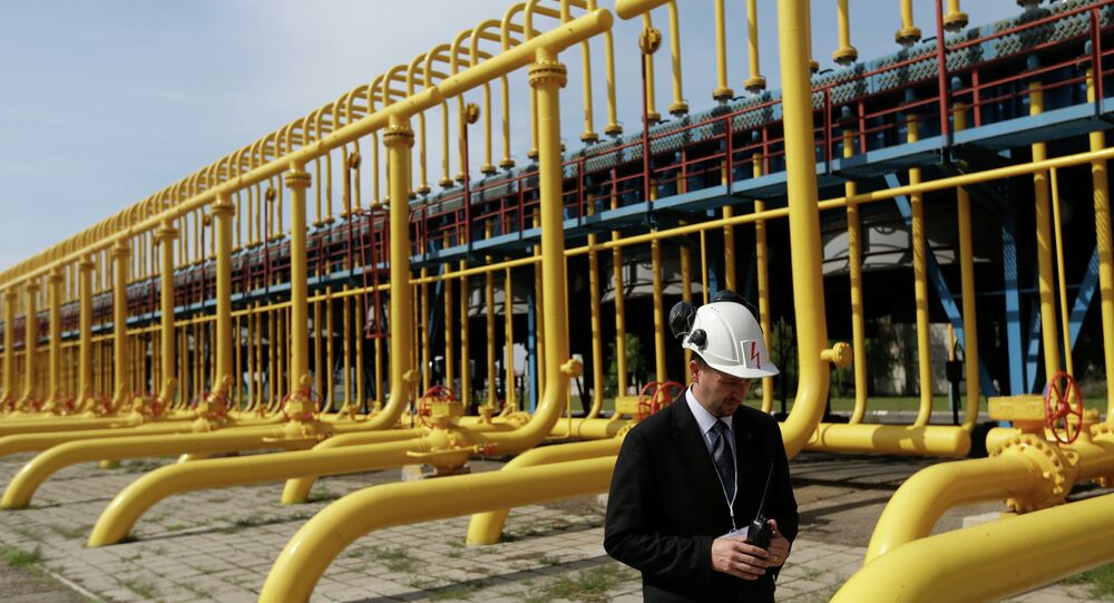 An employee walks past gas pipes at the gas compressor station in Velke Kapusany, Slovakia